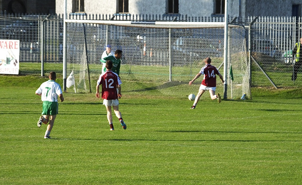 Kieran Byrne continues his fine form by putting the ball in the Ballinacor net. He  wins a penalty later in the game