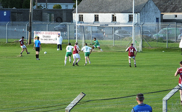 Mikey Mangan takes the penalty for Stratford Grangecon after Kieran Byrne was fouled but the shot goes wide