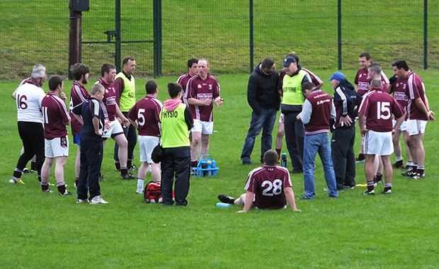 The Junior team management provide instructions and encouragement for the second half