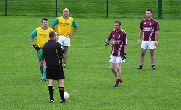 Midfielders James Whelan and Ger O'Keeffe go in for the second half throw in