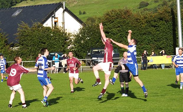 Joe O'Neill wins the high ball from a kick out